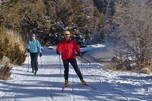 Yellowstone Cross Country Skiing Adventures :: Bundle up and explore the snowy wonderland of Yellowstone with a variety of winter activities. Hear the howl of a distant wolf or spot a slow-moving, frost-covered bison.