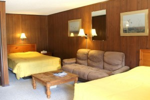Corral Motel, Bar and Steakhouse :: One of Big Sky's best hangouts, the Corral's legendary food & drink captivate guests on the way to and from Yellowstone. Rooms feature WiFi, 2 queens, fridge, cable & coffee.