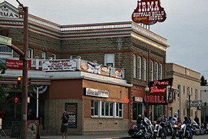 "Buffalo Bill's Irma Hotel: A Historic ""Gem"" :: You'll be comfortable at the Irma. It's a place fancy enough for royalty and plain enough for cowboys and cowgirls. You'll love the Irma Hotel. On Main Street."