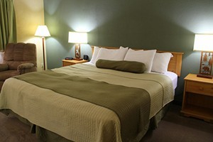Western Heritage Inn - downtown's best value :: Newly-renovated rooms & suites near shops, dining, art & cultural festivals. AAA rated, hot tub/steam room & complimentary hot breakfast. Book online or call 800.877.1094.