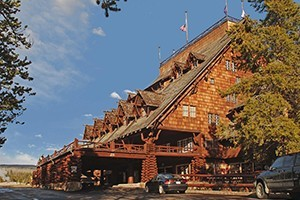 Historic Old Faithful Inn and World-Famous Geyser :: A national historic landmark that is the most requested lodging in the park, the Old Faithful Inn is a striking log structure located near the Old Faithful's spectacular show.