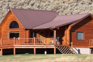 Family Log Lodges, Cabins & Home Rentals : Modern, large log lodges and 1- or 2-bedroom rustic cabins 35 minutes to West Yellowstone. Private access to uncrowded mountain lake; 10 minutes from famous Madison River.