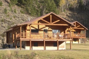 Family Log Lodges & Upscale Cabins & Home Rentals : Modern, large log lodges and 1- or 2-bedroom rustic cabins 35 minutes to West Yellowstone. Private access to uncrowded mountain lake; 10 minutes from famous Madison River.